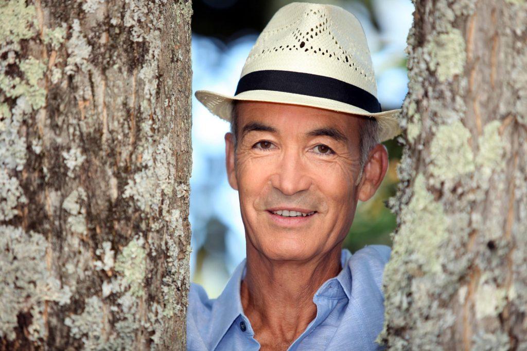 man smiling posing looking at camera